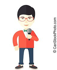 Reporter. - An asian reporter wearing red glasses speaking...