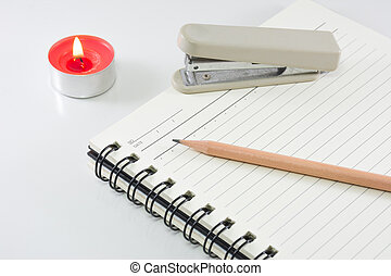 Hard cover note book with pencil on white background