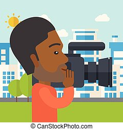 Cameraman - An african-american hipster cameraman with video...