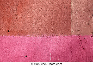 Pink and orange grunge plaster wall texture.