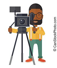 Cameraman. - An african-american cameraman with beard and...