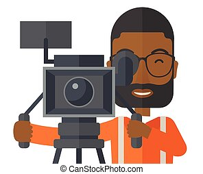 Cameraman - An african-american cameraman with beard and...