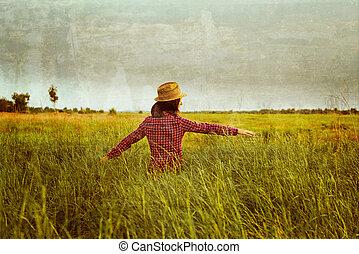 Woman walks in green meadow - Hipster woman walks in summer...