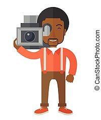 Cameraman - An african-american cameraman with video camera...