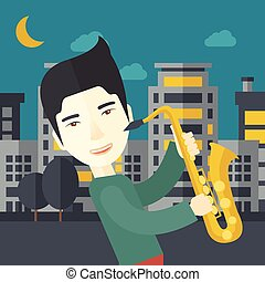Saxophonist. - An asian musician playing saxophone in the...