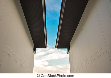 Two building wall with beuatiful blue sky in center, use for art style