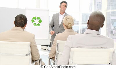 Confident business man presenting the concept of recycling...