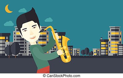 Saxophonist - An asian musician playing saxophone in the...