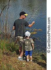teach a boy to fish - a father teaches his son to fish
