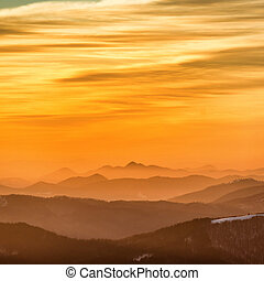 Sunset in winter mountains covered with snow.