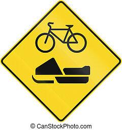 Snowmobile AndBicycle Warning in Canada - Warning road sign...