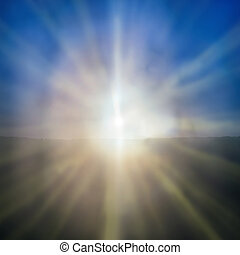 Abstract sunset- shining sun with sunbeams on the blue sky...