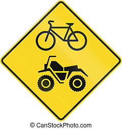 Bicycle And ATV Warning in Canada - Warning road sign in...