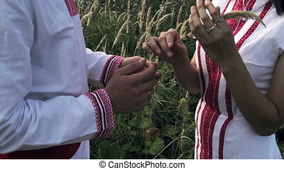 loving couple in Russian folk costumes are holding spike HD