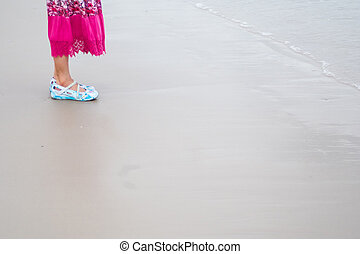 lonely girl - asian woman with pink long skirt and blue...
