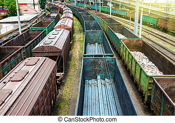 Many trains with cargo wagons
