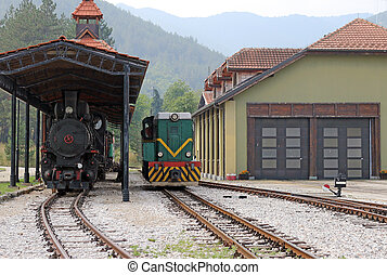 railroad station with old trains