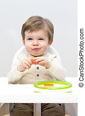 Toddler Healthy Snacking - Close up image of a baby boy...