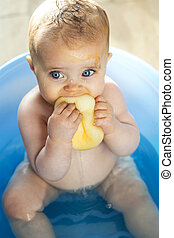 Baby's Bathtime - Messy baby in the bath, trying to eat a...