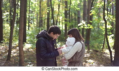Family with child go in autumn park - Happy Family with...