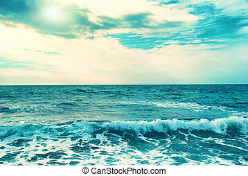 Blue sea- only shining sun, water, waves and clouds