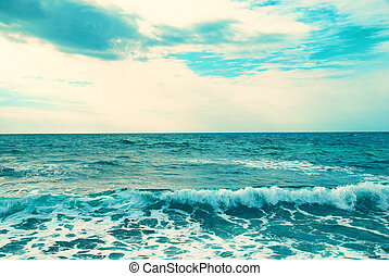 Blue sea- only water, waves and clouds