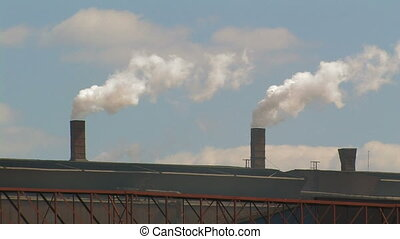 Smoking Chimneys at a Factory - Smoking chimneys on a Roof...