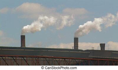Smoking Chimneys at a Factory