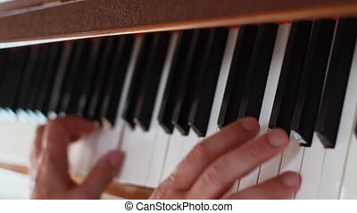Piano - being played - Piano - hands playing the instrument