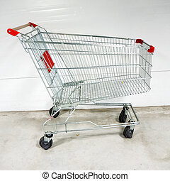 Empty shopping cart- trolley in the supermarket