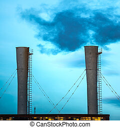 Industrial black toxic smoke from coal power plant on blue...
