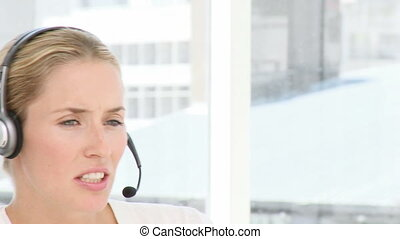 Business woman with headphones in a company