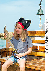 Little girl in pirate costume with sword