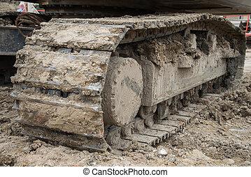 Wheel loader Excavator with backhoe unloading sand at eath...