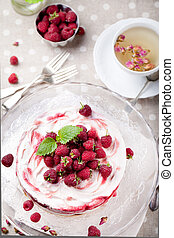 Raspberry, rose cheesecake with a cup of tea - Raspberry,...