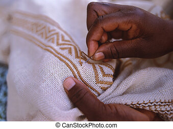 hands of an African woman who sews