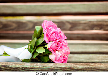 Bridal bouquet of roses on the bench