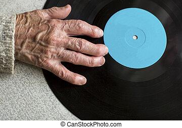 Senile hand is on vinyl LP.