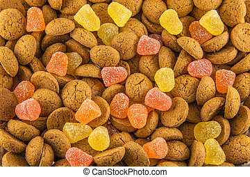 Pepernoten and yellow and red candy - Sinterklaas background...