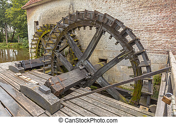 Paddle wheels at a watermill - Water wheel driven watermill...