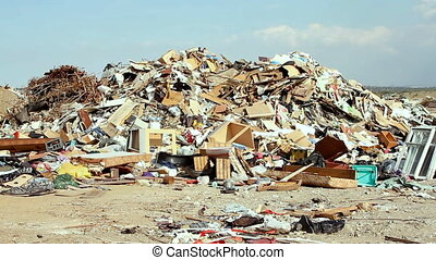 Large garbage dump waste over blue sky - Big garbage dump...