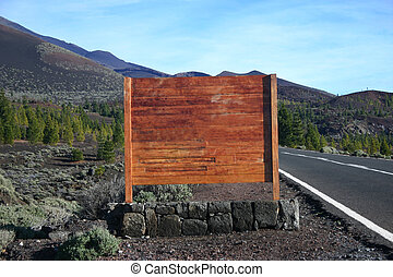 Blank wooden sign next to road - blank wooden sign next to...