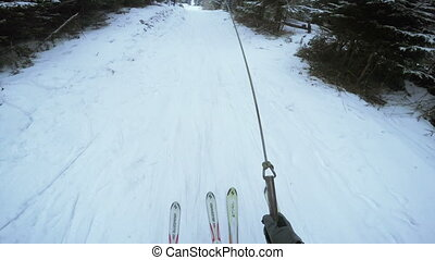 Ascent to rope tow - Girl with instructor climbing rope tow...