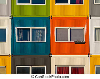 colorful cargo containers used as home by students to solve...