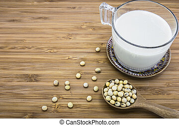 Soymilk from soybeans - A cup of soymilk with soybean and on...