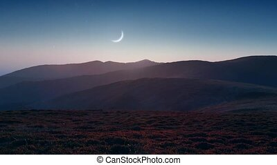 Setting moon over the mountains - Picturesque mountain scene...