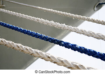 ropes - three white and one blue rope in front of a ship