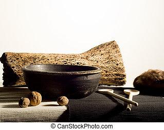 Stillife - stillife with bark, bowl walnuts and spoons