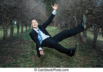 Man falls in the park The smile on his face, he is happy