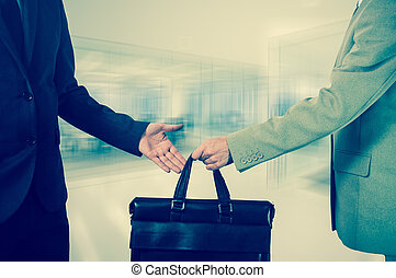 business transfer. handover of a suitcase partners -...